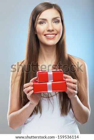 Woman hold gift box, beauty portrait. Young model.