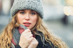 Woman Hold Her Scarf While Walking On The Street. Portrait Of Stylish Smiling Woman In Winter Clothes Holding Scarf. Female Winter Style. - Image