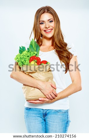 woman hold shopping bag with green vegan food. white background .