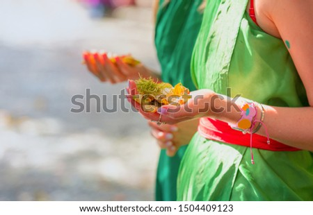 Woman hold traditional hinduist offerings to gods including  flowers and aromatic sticks -Pura Tirtha Empul Temple, Indonesia