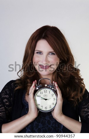 woman holding a bedside alarm watch