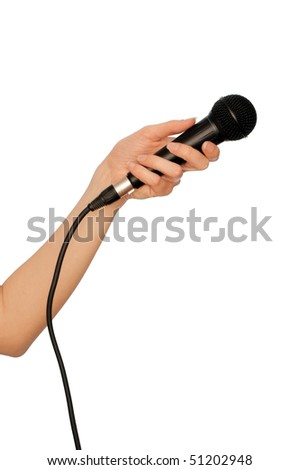 woman holding a black microphone for singing, speaking and speech