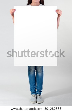 Woman holding a blank  A1 poster #301282835