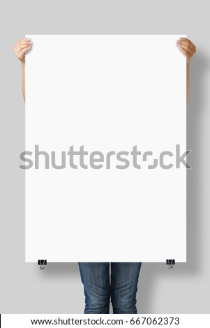 Woman holding a blank A0 poster mockup isolated on a gray background. #667062373