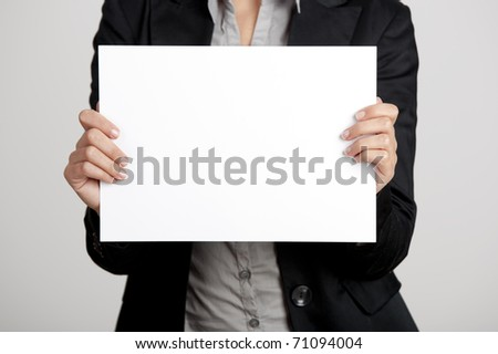 Woman holding a blank paper sheet with both hands