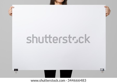 woman holding a blank poster 100x70 mockup stock photo. Black Bedroom Furniture Sets. Home Design Ideas