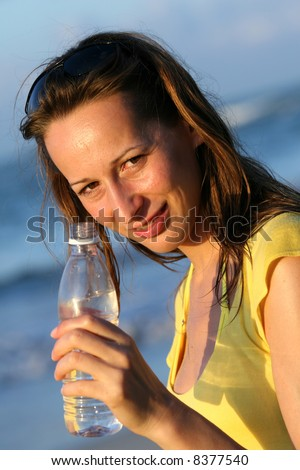 Woman holding a bottle water in her hand
