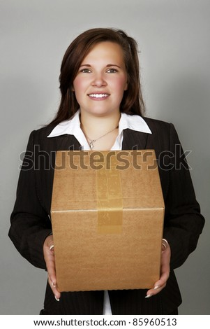 woman holding a card board box