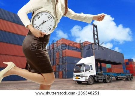 Woman holding a clock in a hurry with the delivery of Business for shipping on time.