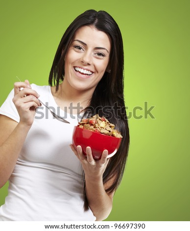 woman holding a delicious red breakfast bowl against a green removable chroma background background background