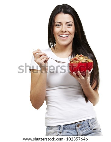 woman holding a delicious red breakfast bowl against a white background