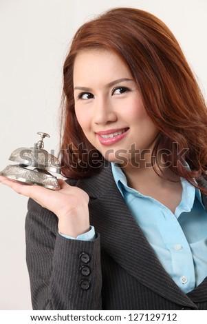 woman holding a desk bell