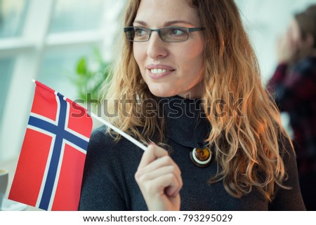 Woman holding a flag of Norway.