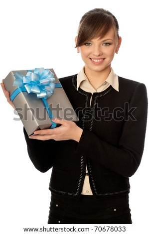 Woman holding a grey box with blue bow as a present