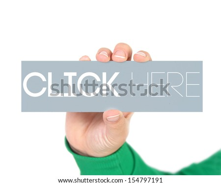 woman holding a label with click here written on it with focus on her hand