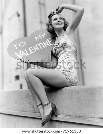 Woman holding a large valentine