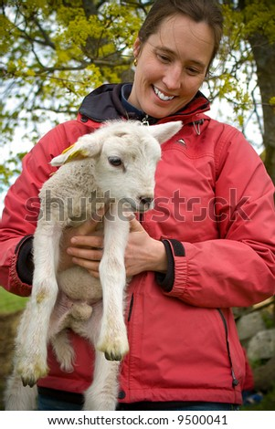 woman holding a little lamb