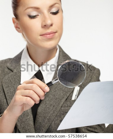 woman holding a magnifying glass in the hand