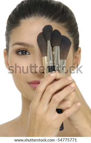 woman holding a make-up brush