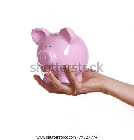 Woman holding a pink piggy bank.