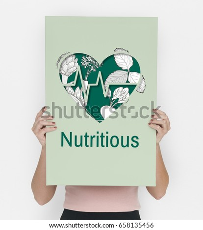 Woman holding a placard with nutritious heart graphic