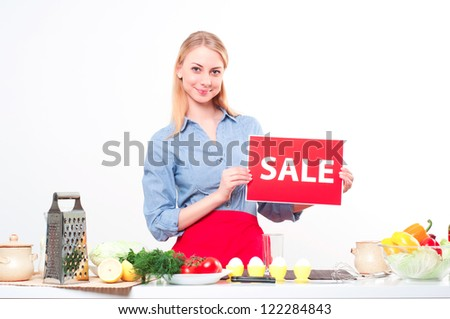 woman holding a plate with an inscription Sale