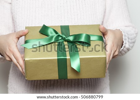 Woman holding a present #506880799