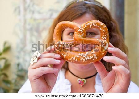 Woman holding a pretzel, Munich, Bavaria, Germany