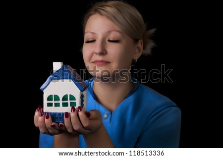 woman holding a small house - stock photo