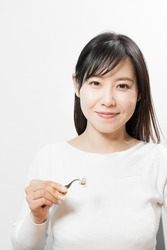Woman holding a stamp with tweezers