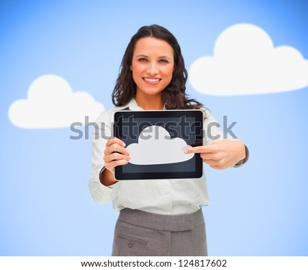 Woman holding a tablet pc while smiling against blue background with clouds