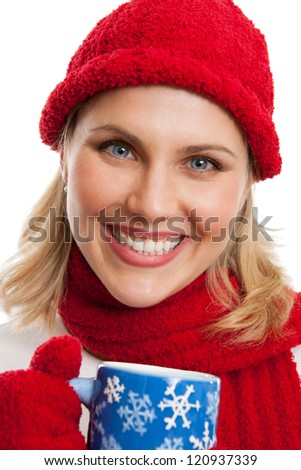 Woman holding a winter coffee cup isolated on white