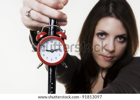 woman holding a wrist watch made into a small alarm clock