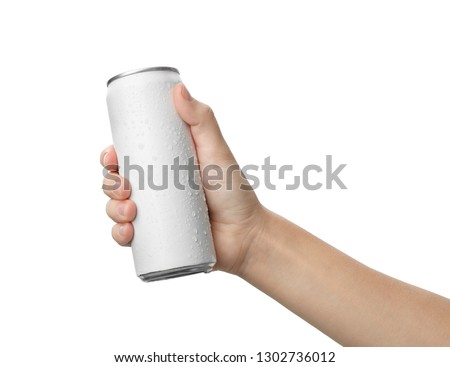 Woman holding aluminum can with beverage on white background, closeup. Space for design