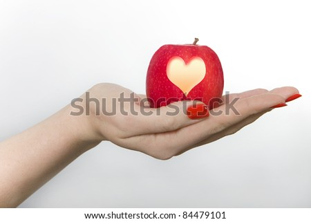 Woman Holding an Apple Carved with a Heart