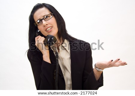 Woman holding an old school phone arguing