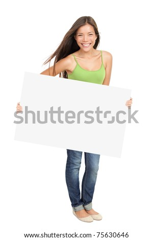 Woman holding billboard sign smiling fresh. Caucasian / Asian woman isolated on white background in full figure.