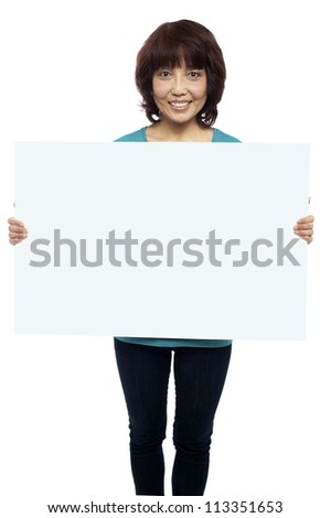 Woman holding billboard, your ad here. Isolated on white