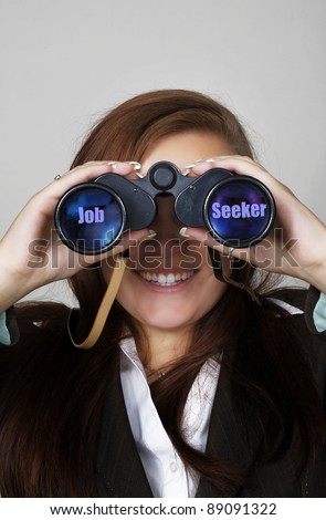 woman holding binocular up to her eyes