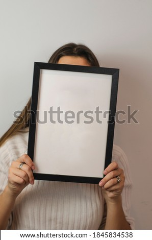 woman holding black photo frame with white background Photo stock ©