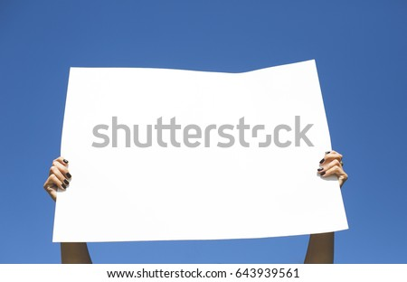 Woman holding blank protest sign