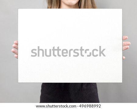 woman holding blank sign poster