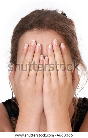 Woman holding both hands in front of her eyes