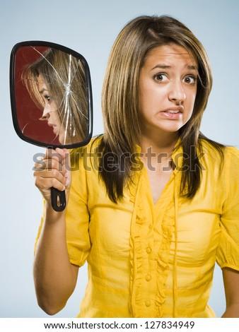 Woman Holding Broken Hand Held Mirror Stock Photo