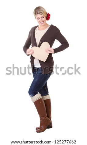 woman holding brown vintage heart full length isolated on white