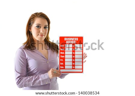 "Woman holding ""business hours"" sign"
