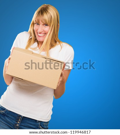 Woman Holding Cardboard box against a blue background