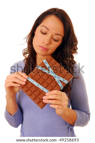 Woman holding chocolate bar with tape measure