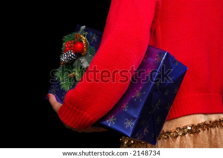 Woman Holding Christmas Present Under Her Arm