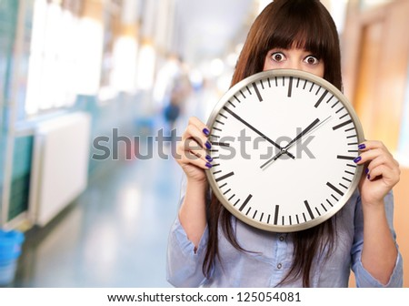 Woman Holding Clock, Indoor - stock photo